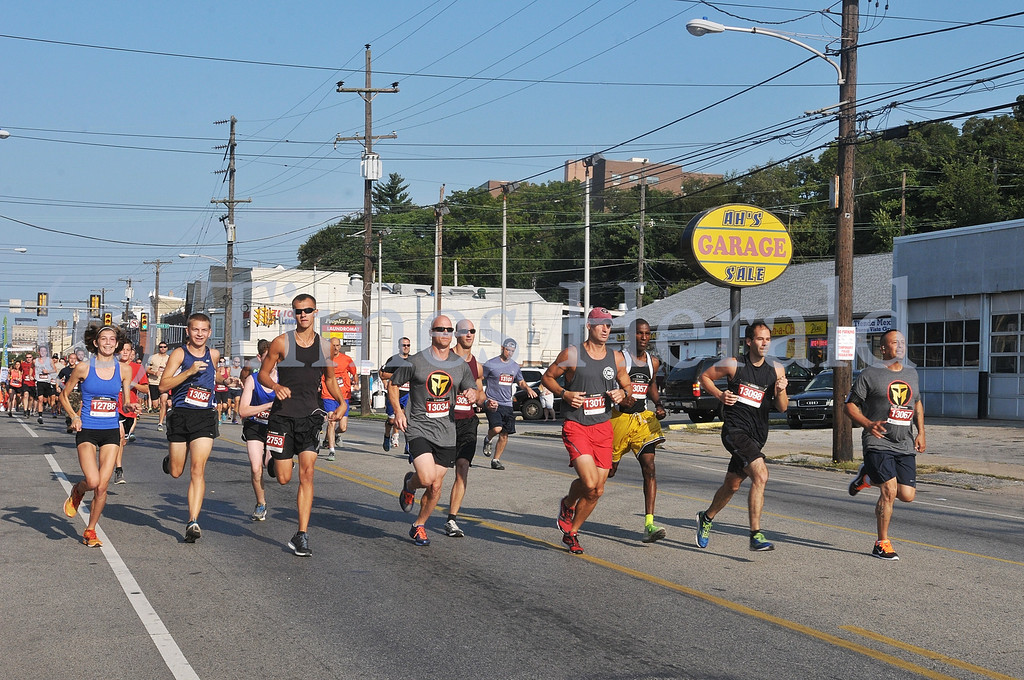 Description of . The runners begin the race at the 9/11 Heroes Run on Main Street in Norristown.  Sunday, September 8, 2013.  Photo by Adrianna Hoff/Times Herald Staff.