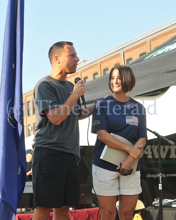 Description of . Montgomery County Commisioner Josh Shapiro and District Attorney Risa Vetri Ferman thank the supporters for the 911 Heroes Run.  Sunday, September 8, 2013.  Photo by Adrianna Hoff/Times Herald Staff.