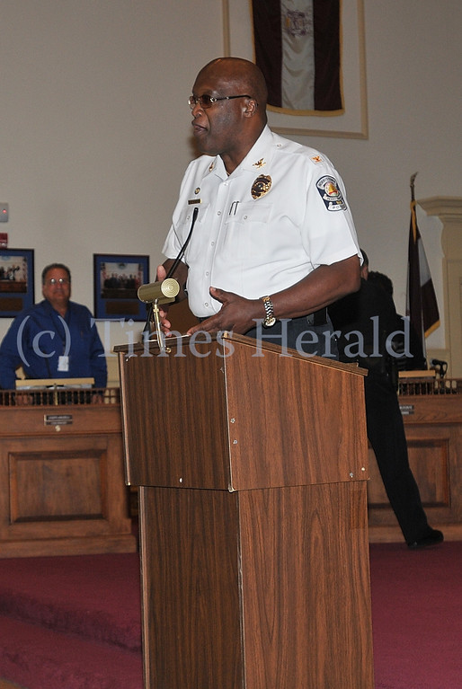 Description of . Norristown Police Chief Willie G. Richet praises the efforts of Officer Jason Hoover.  Tuesday, October 15, 2013.  Photo by Adrianna Hoff/Times Herald Staff.