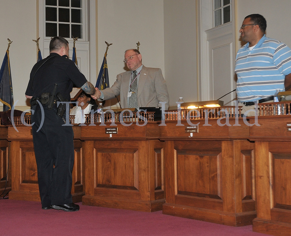 Description of . Photographs from the Norristown Municipal Meeting on Tuesday evening.
