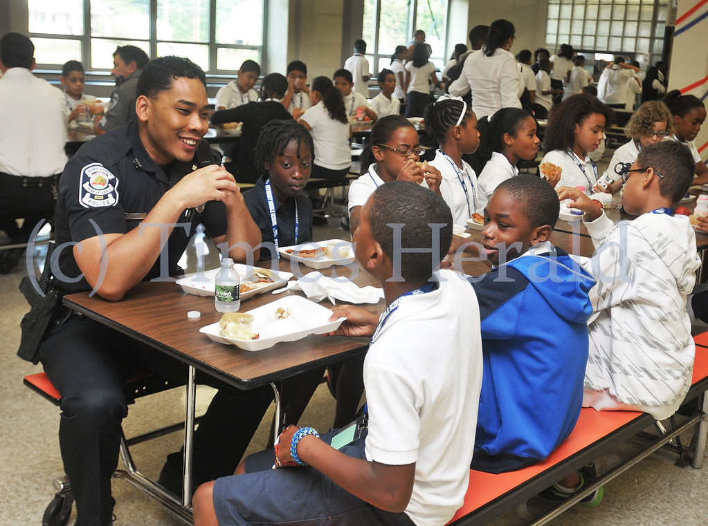 Description of . Norristown Officer Steven Sowell speaks to fifth graders during lunch at Stewart Middle School.  Wednesday, September 11, 2013.  Photo by Adrianna Hoff/Times Herald Staff.