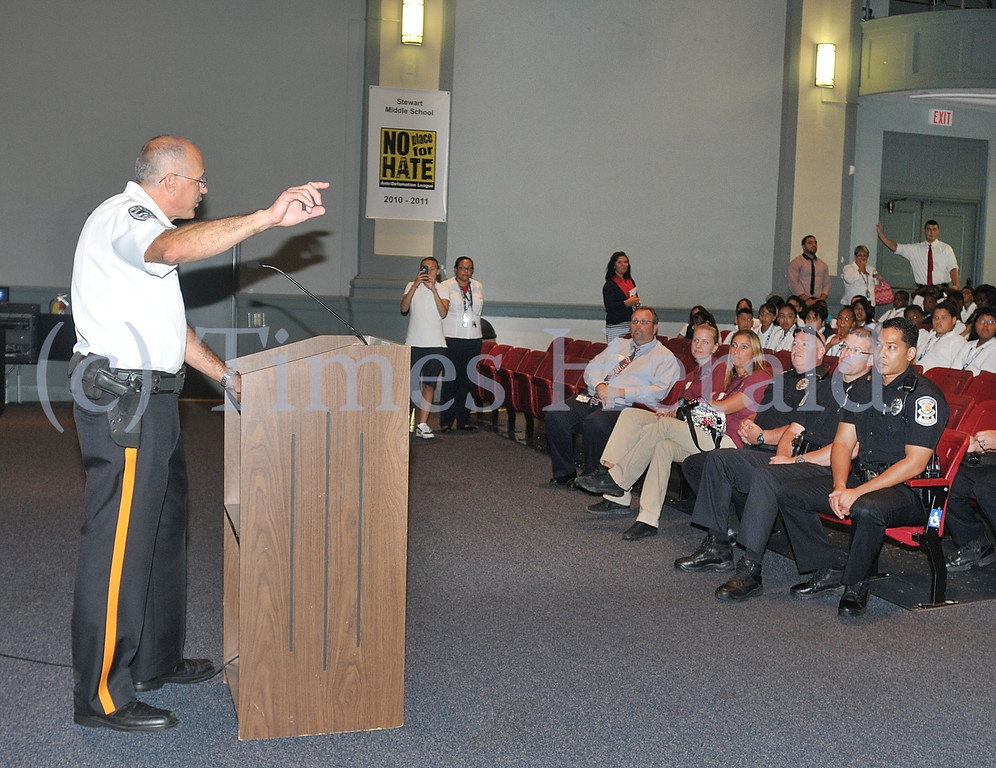 Description of . West Norriton Chief of Police Dale Mabry talks to fifth graders in the Stewart Middle School Auditorium and explains some of the police officers duties.  Wednesday, September 11, 2013.