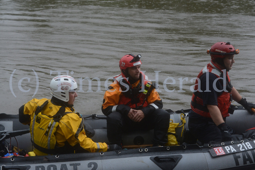 Description of . A man riding a jet ski was rescued by emergency personnel on the Schyulkill River.  Norristown, June 13, 2014.  Photo by Adrianna Hoff/Times Herald Staff.