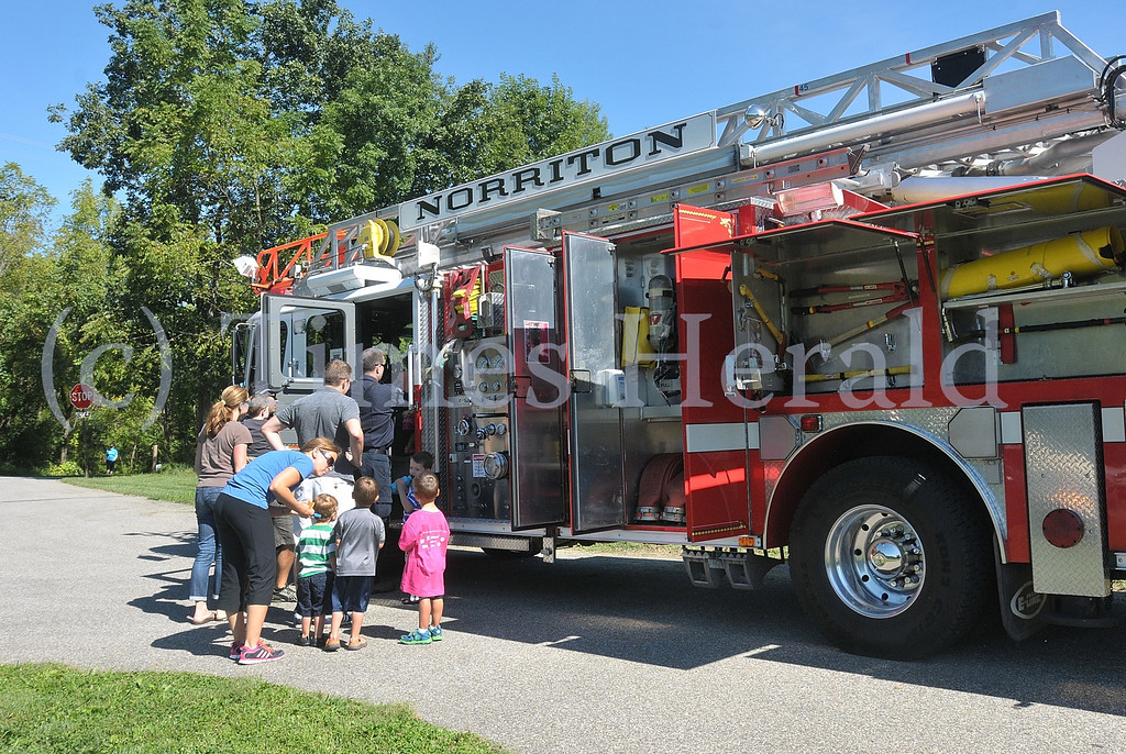Description of . East Norriton Fire Department came out to allow kids to check out their fire engines and support the event.  Saturday, September 7, 2013.  Photo by Adrianna Hoff/Times Herald Staff.