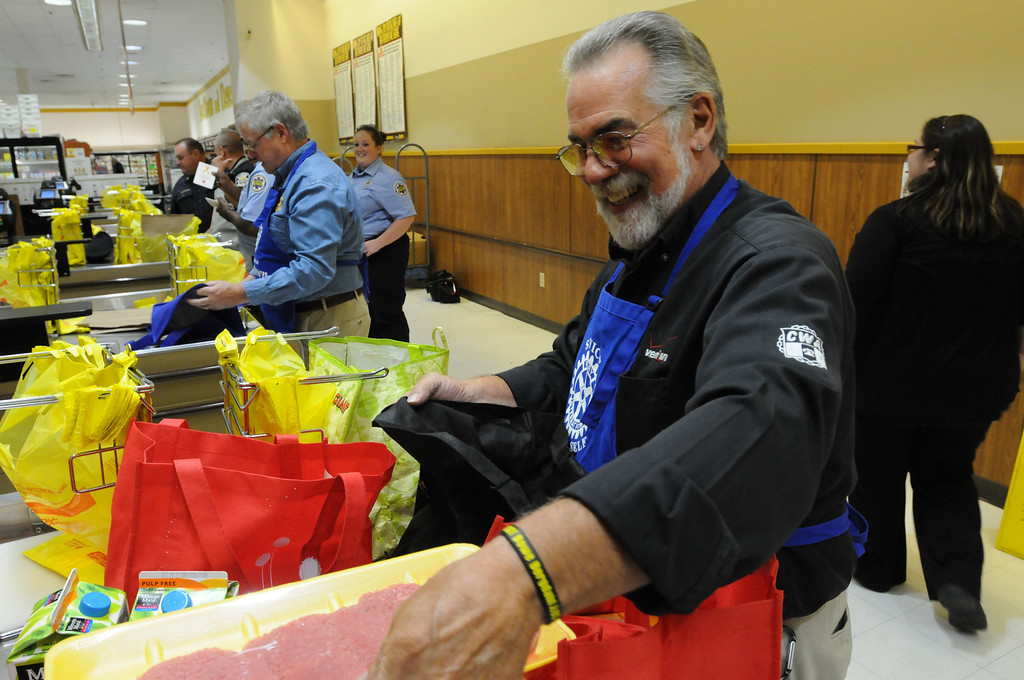 Description of . Area civic and professionals volunteer to bag food during the East Norriton Shop Rites Bag for Hunger Sept. 18, 2013. Photo by Gene Walsh / Times Herald Staff