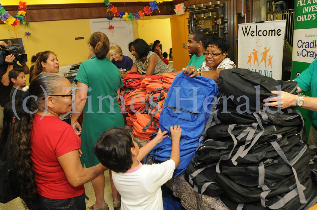 Description of . Children receive a free backpack filled with school supplies as part of Citizen Bank's Gear for Grades initiative at ACLAMO in Norristown Aug. 26, 2014. Photo by Gene Walsh / Times Herald Staff