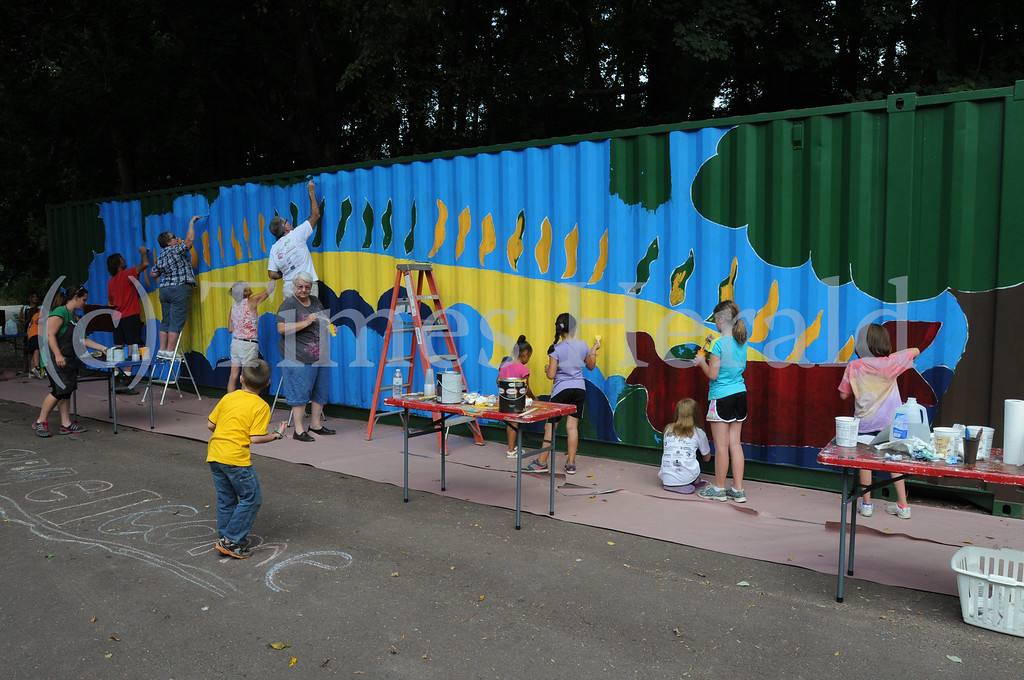 Description of . Members of the ACPPA Community Art Center paint shipping container at the Norristown Riverfront Park in Norristown Monday August 26, 2013. Photo by Gene Walsh / Times Herald Staff
