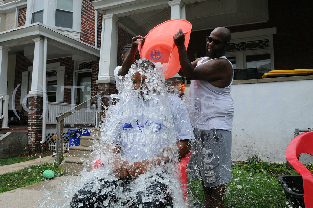Description of . Michael Swittenburg and Candy Bassmore take the Ice Water Challenge in Norristown to help raise funds for charities of their choice Thursday July 3, 2014. Photo by Gene Walsh / Times Herald Staff
