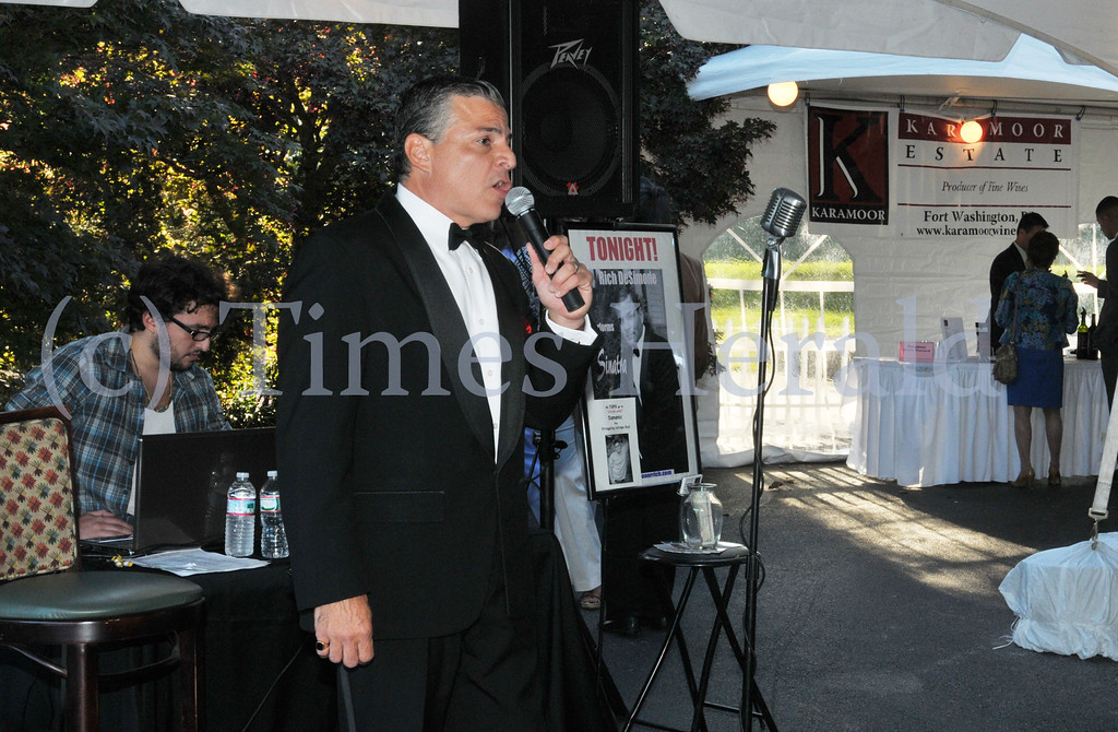 Description of . Rich DeSimone sings songs by Sinatra for the crowd during the 13th Annual International Food and Wine Extravaganza at the Plymouth Country Club.  Thursday, September 5, 2013.  Photo by Adrianna Hoff/Times Herald Staff.