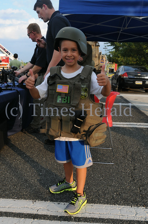 Description of . Families enjoy Plymouth's National Night Out event in the Plymouth Metroplex August 5, 2014. Photo by Gene Walsh / Times Herald Staff