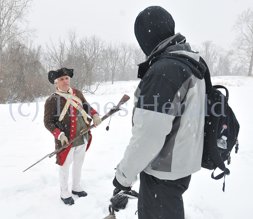 Description of . Private Daniel Kinnamon of the 9th Pennsylvania regiment of Reenactors explains musket use for soldiers during the Revolutionary War.  Saturday, February 15, 2014.  Photo by Adrianna Hoff/Times Herald Staff.