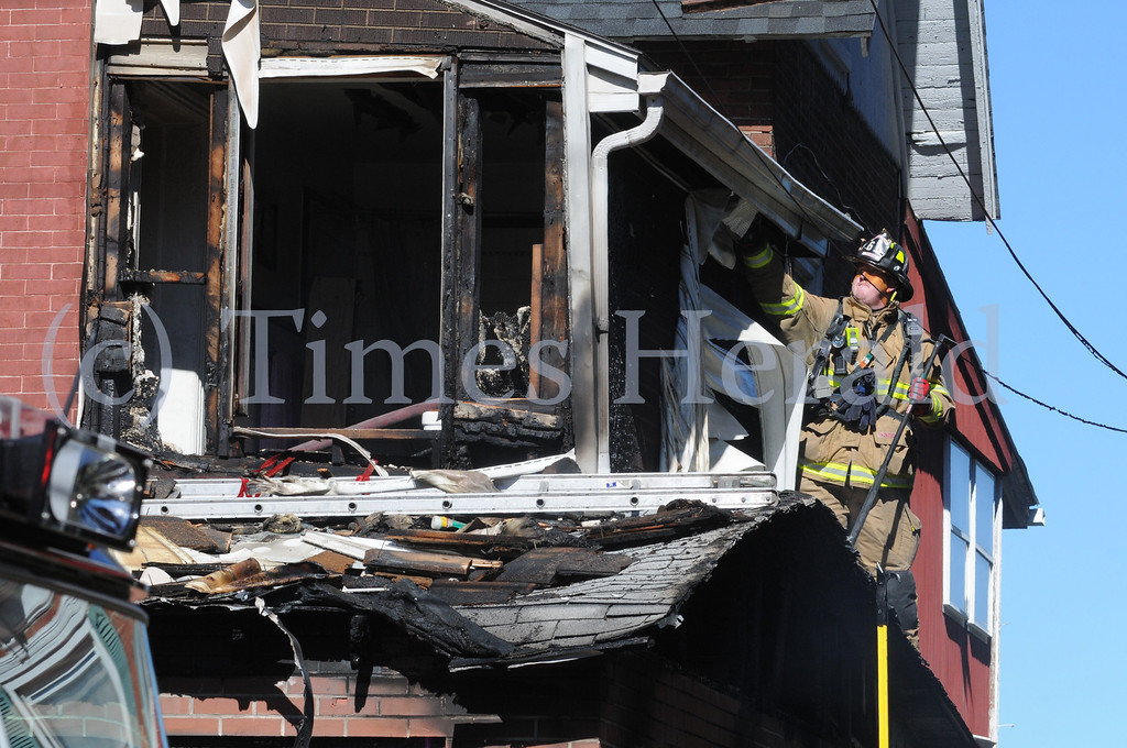 Description of . Fire damages home at 209 Bridge St. in Upper Providence Sept. 17, 2013. Photo by Gene Walsh / Times Herald Staff