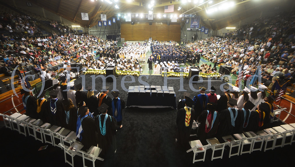 Description of . Graduates finish filing into their seats during the Upper Merion High School Graduation at the Pavilion at Villanova.  Tuesday, June 10, 2014.  Photo by Adrianna Hoff/Times Herald Staff.
