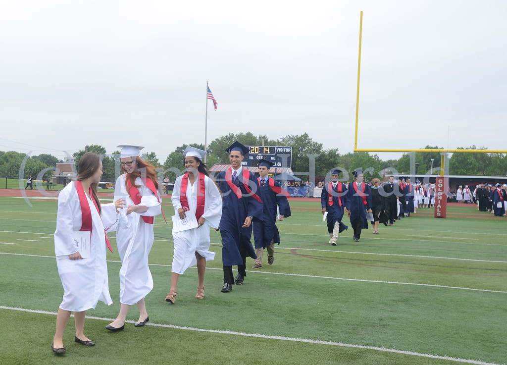 Description of . Plymouth Whitemarsh High School celebrates their 2014 Commencement at Colonial Field.  Whitemarsh, June 11, 2014.  Photo by Adrianna Hoff/Times Herald Staff.
