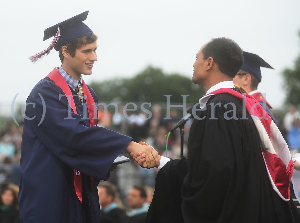 Description of . Brad Peter Keller shakes Principal Jason R. Bacani's hand after accepting his diploma.  Wednesday, June 11, 2014.  Photo by Adrianna Hoff/Times Herald Staff.