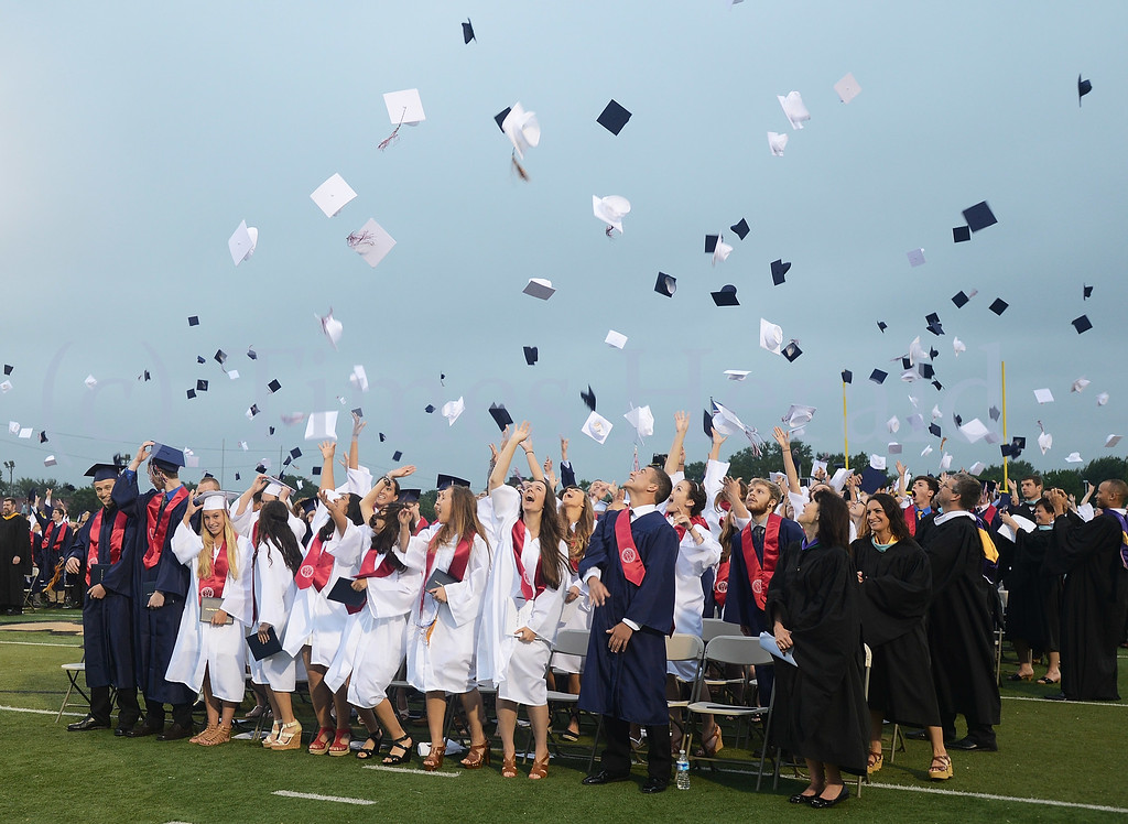Description of . Plymouth Whitemarsh graduates throw up their caps in celebration at the end of the 2014 Graduation.  Wednesday, June 11, 2014.  Photo by Adrianna Hoff/Times Herald Staff.