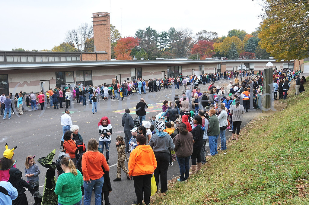 Description of . Students, teachers, and parents gather for Whitemarsh Elementary's annual Halloween Parade.  Thursday, October 31, 2013.  Photo by Adrianna Hoff/Times Herald Staff.