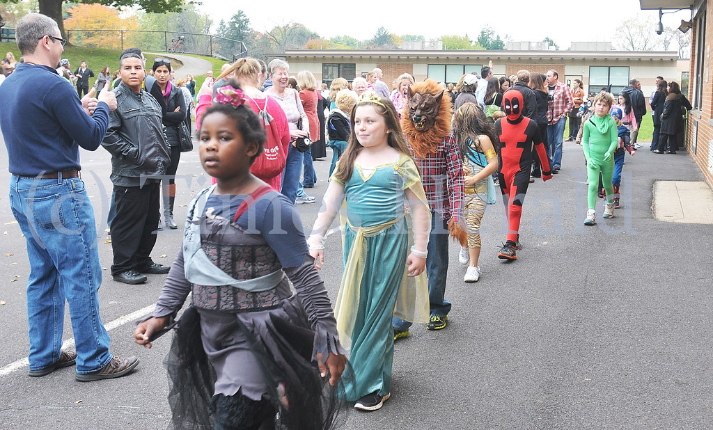 Description of . Whitemarsh Elementary School holds their annual Halloween Parade.  Whitemarsh, October 31, 2013.  Photo by Adrianna Hoff/Times Herald Staff.