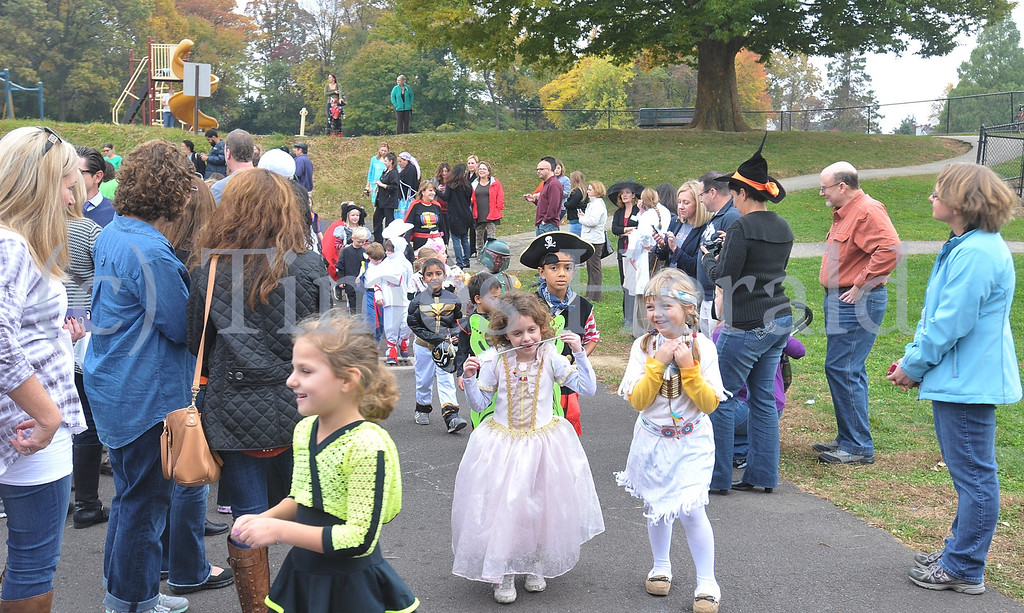Description of . Children walk around Whitemarsh Elementary School showing off their costumes during the annual Halloween Parade.  October 31, 2013. Photo by Adrianna Hoff/Times Herald Staff.
