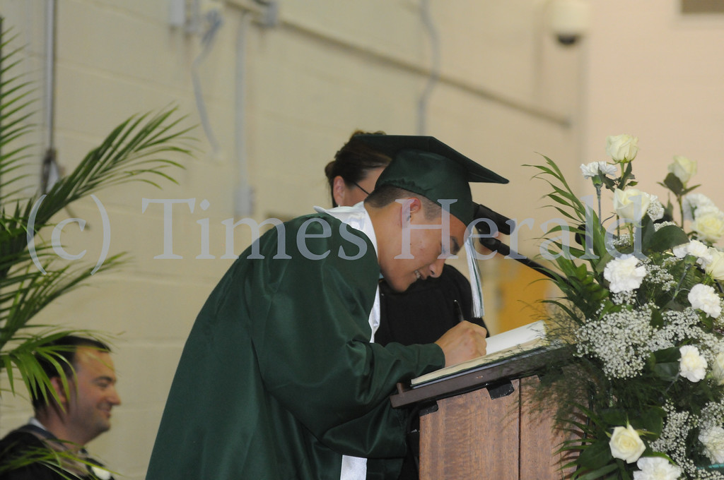 Description of . Mewthacton seniors graduate during commencement ceremony in Worcester June 12, 2014. Photo by Gene Walsh / Times Herald Staff