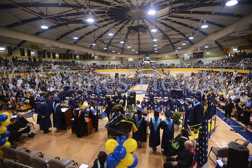 Description of . Graduates line up on both sides of the podium to receive their diplomas. Thursday, June 12, 2014.  Photo by Adrianna Hoff/Times Herald Staff.