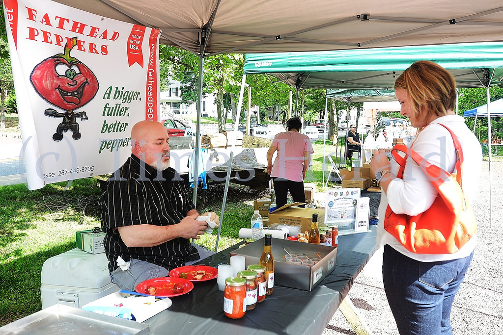 . Skippack Farmers Market gets started on Friday evening with Food Trucks, Vegetable Stands, and Artisan Booths.  Friday, May 30, 2014.  Photo by Adrianna Hoff/Times Herald Staff.