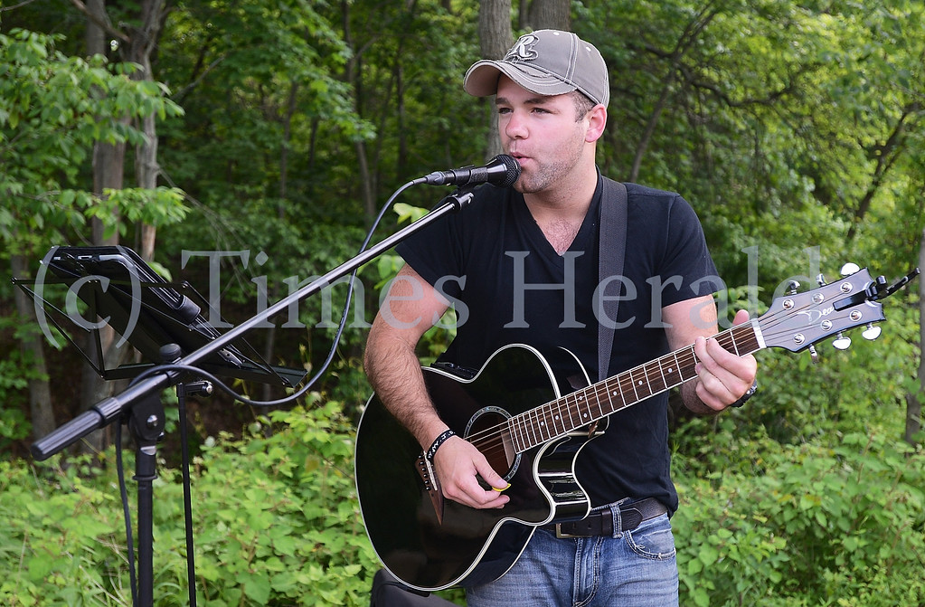 . G. Tyler Hunsberger gets the night started with live music at the Skippack Farmers Market.  Friday, May 30, 2014.  Photo by Adrianna Hoff/Times Herald Staff.