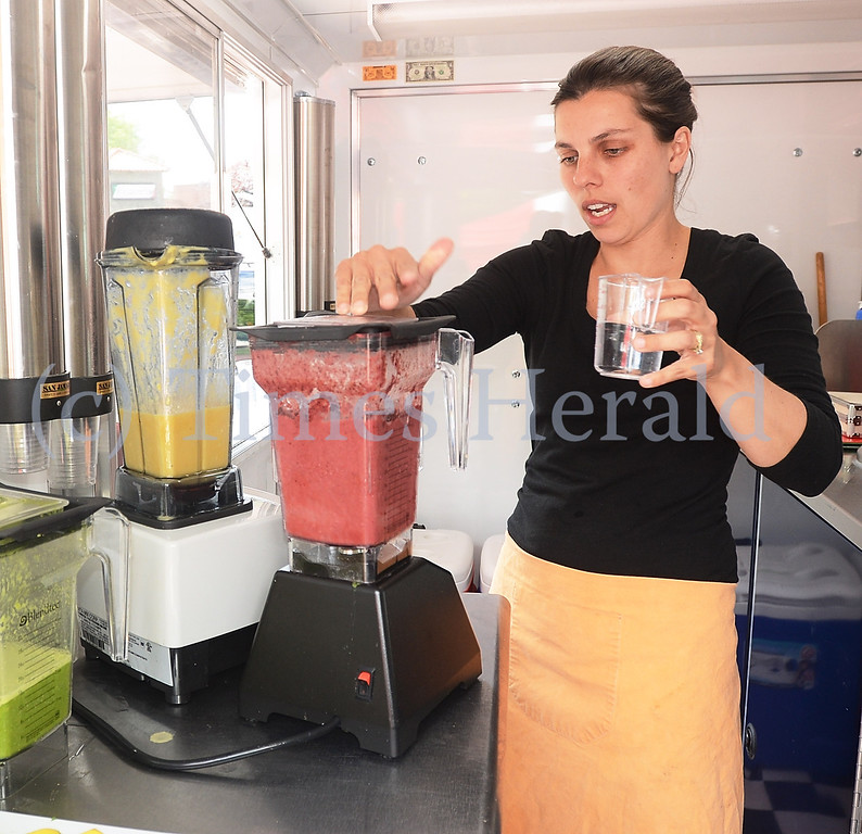 . Maria King of OMG Smoothies Food Truck, mixes up a fresh batch for the start of the Farmers Market.  Friday, May 30, 2014.  Photo by Adrianna Hoff/Times Herald Staff.