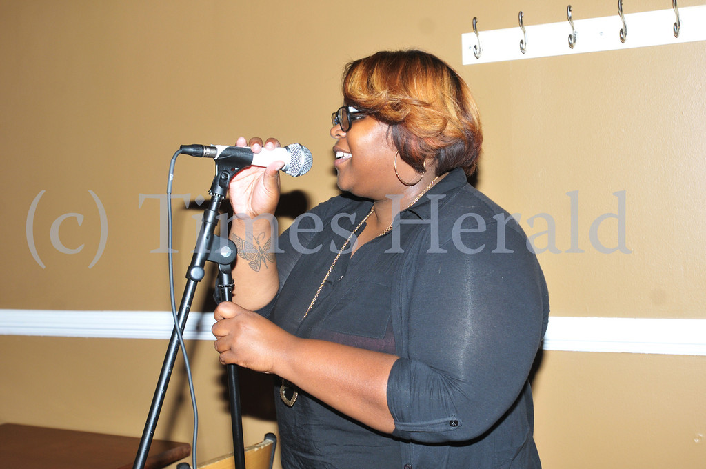 """. Mydera Robinson performs her poem \""""Peace by Piece\"""" at Jus\' Java\'s \""""Open Words\"""" event in Norristown.  Wednesday, September 4, 2013.  Photo by Adrianna Hoff/Times Herald Staff."""