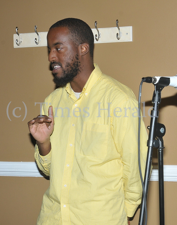 """. Christopher K.P. Brown performs his poem \""""Death vs. Destiny\"""" at Jus\' Java in Norristown.  Wednesday, September 4, 2013.  Photo by Adrianna Hoff/Times Herald Staff."""
