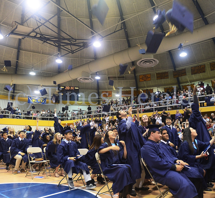 . The Class of 2014 from Wissahickon High School throw up their caps in celebration.  Thursday, June 12, 2014.  Thursday, June 12, 2014.  Photo by Adrianna Hoff/Times Herald Staff.