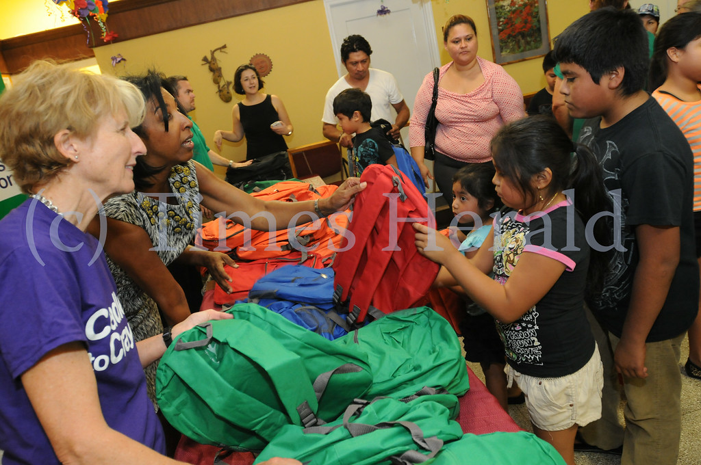 . Children receive a free backpack filled with school supplies as part of Citizen Bank\'s Gear for Grades initiative at ACLAMO in Norristown Aug. 26, 2014. Photo by Gene Walsh / Times Herald Staff