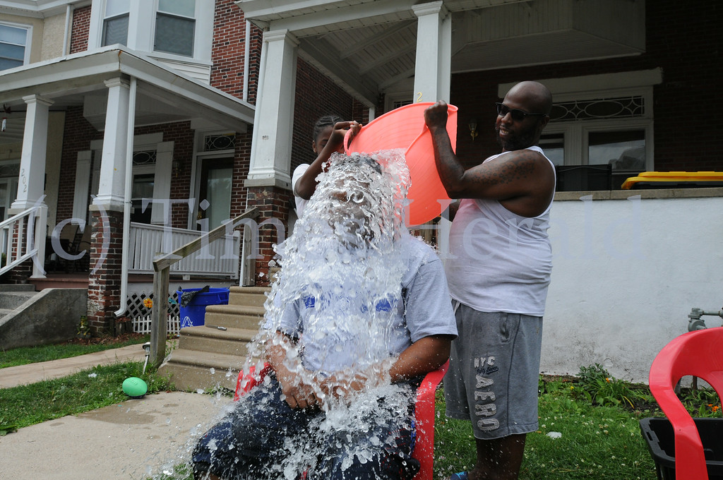 . Michael Swittenburg and Candy Bassmore take the Ice Water Challenge in Norristown to help raise funds for charities of their choice Thursday July 3, 2014. Photo by Gene Walsh / Times Herald Staff