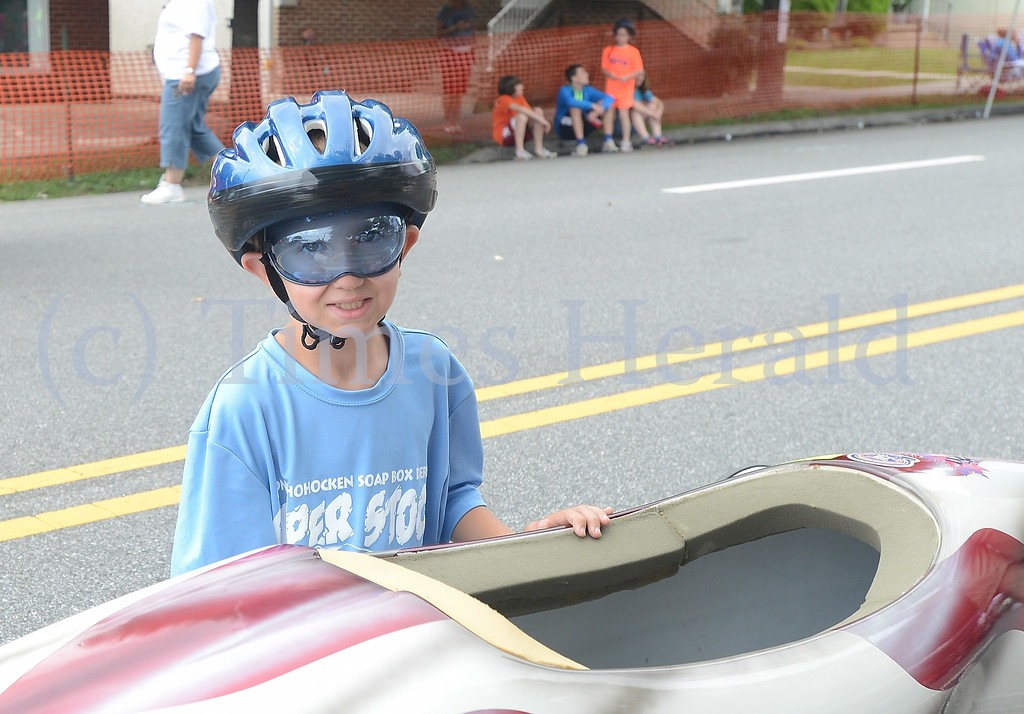 . Vinnie Orler gets ready to race Emily Welsh.  Friday, July 4, 2014.  Photo by Adrianna Hoff/Times Herald Staff.