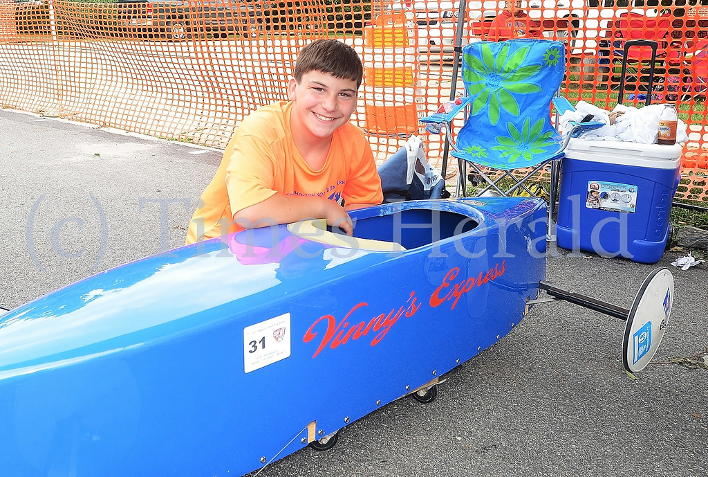 . Vinny Quintiliano sits beside his vehicle Vinny\'s Express.  Friday, July 4, 2014. Photo by Adrianna Hoff/Times Herald Staff.