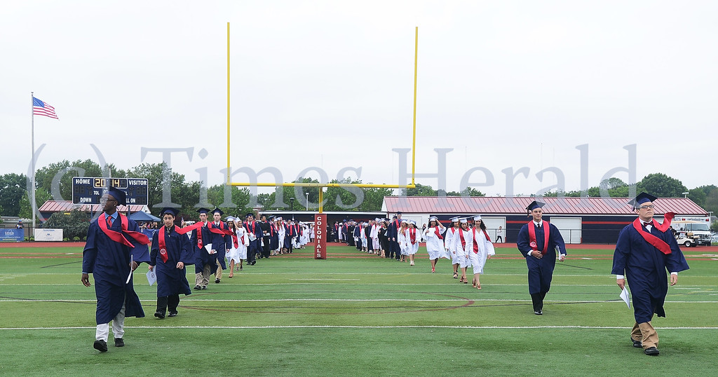 ". The graduating class of 2014 walks onto the field to the tune of ""Pomp and Circumstance\"".  Wednesday, June 11, 2014.  Photo by Adrianna Hoff/Times Herald Staff."