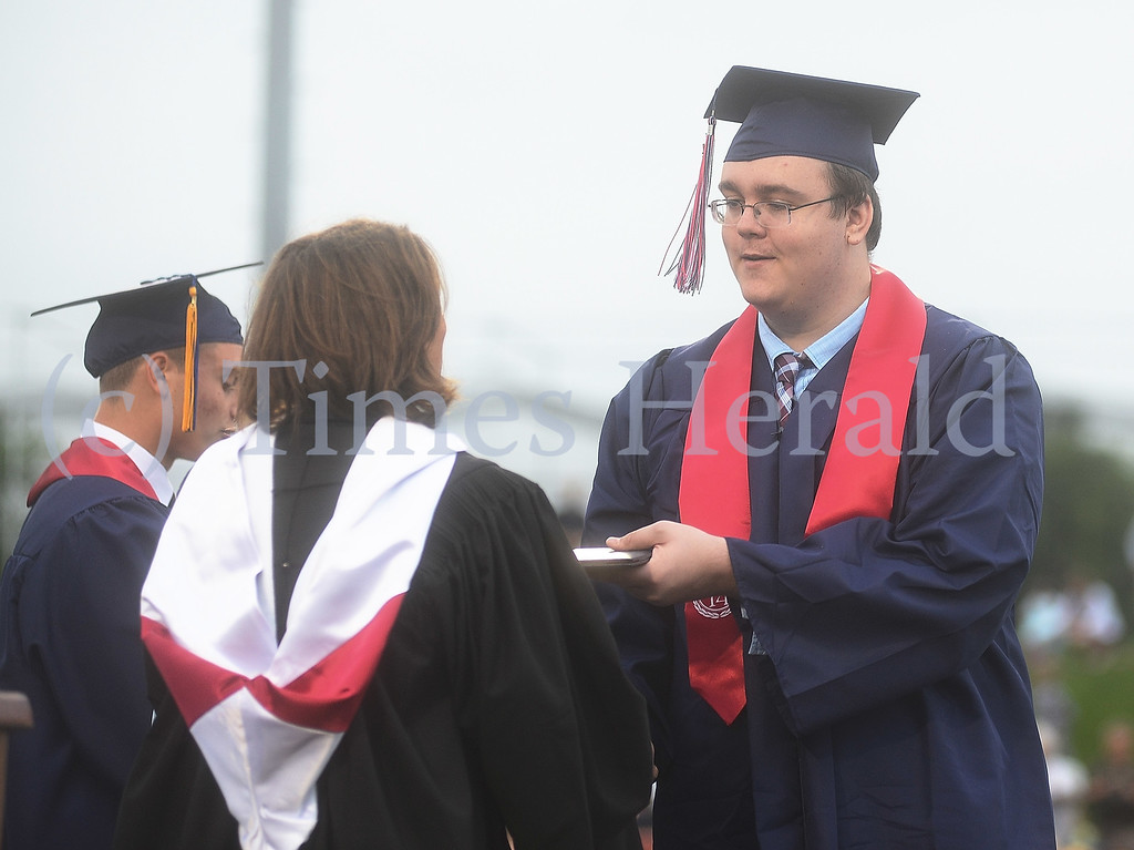 . Eric Andrew Feisleben accepts his diploma at the 2014 Plymouth Whitemarsh High School Graduation.  Wednesday, June 11, 2014.  Photo by Adrianna Hoff/Times Herald Staff.