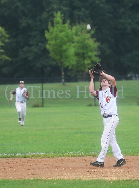. Skippack\'s Connor Breslin catches a pop fly in the infield.  Friday, August 1, 2014.  Photo by Adrianna Hoff/Times Herald Staff.